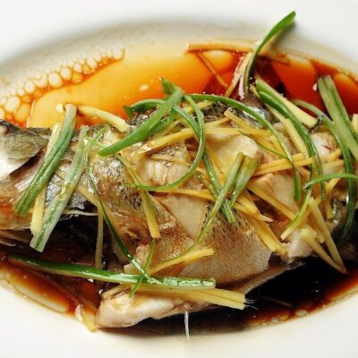 Whole steamed fish with pickled plums